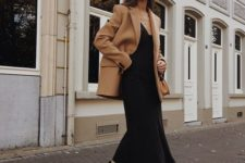 a black slip midi dress, blakc booties and a camel blazer coat for an ultimately elegant look