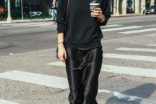 a black sweatshirt, a black slip dress, fuchsia socks and blakc boots for a bold contrasting look
