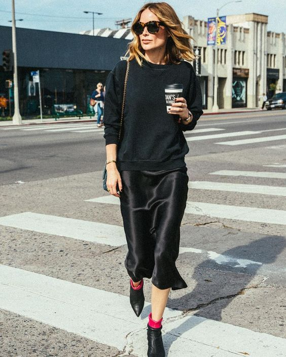 a black sweatshirt, a black slip dress, fuchsia socks and blakc boots for a bold contrasting look