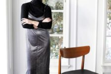 a black turtleneck, a silver slip dress, black tall boots for a monochromatic and shiny look