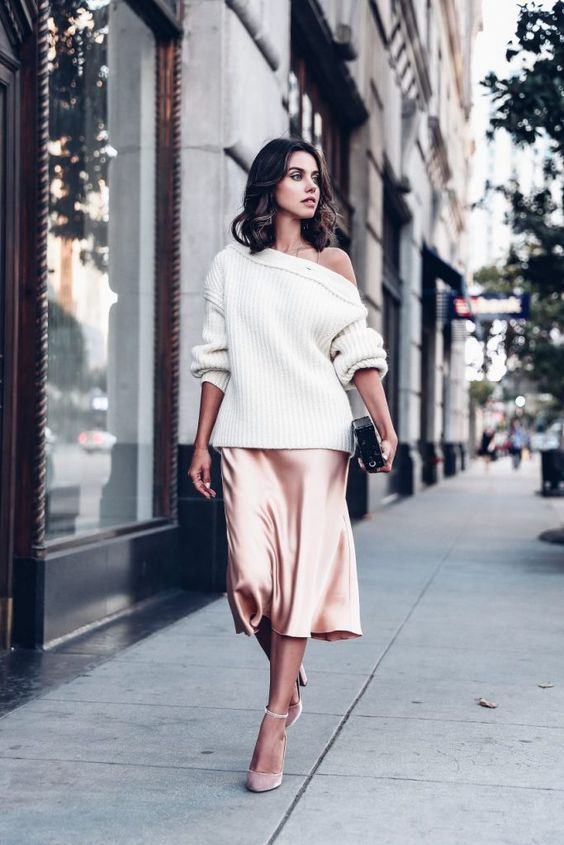 a blush slip dress, an oversized white one shoulder sweater, blush shoes and a clutch for a party