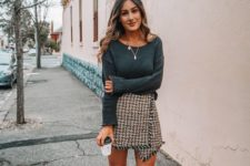 a dark green top, a tweed asymmetrical mini, dark green booties for fall or winter