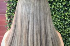 a darker shade of mushroom blond on medium length hair and with dark roots to make a contrast