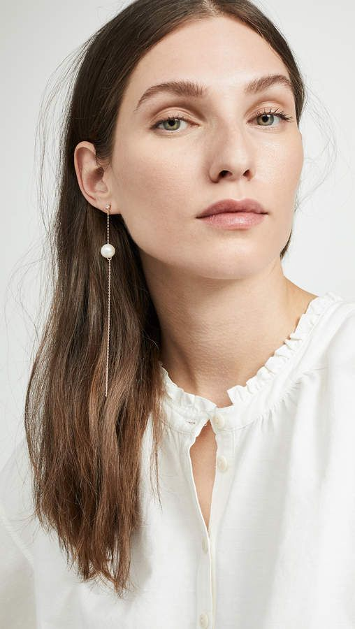 a delicate mono earring of a chain and a pearl on it is a gorgeous idea to go for