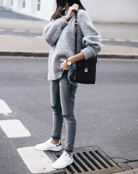 a grey look with an oversized sweater, skinnies, white sneakers and a black bag - add a coat and go