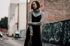 a grey turtleneck, a black slip dress, black booties and a studded bag for a chic winter look