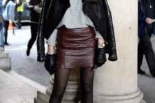 a grey turtleneck, a burgundy leather mini, black tights and booties and a black shearling coat
