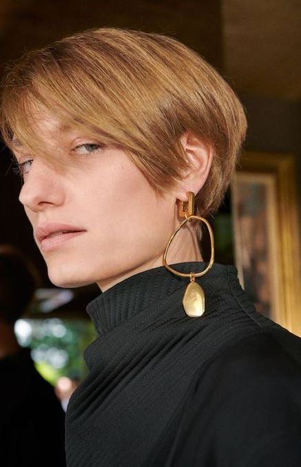 a large and bold mono earring with an asymmetric part and a large stone will spruce up your outfit