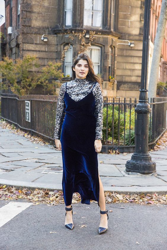 a silver sequin turtleneck, a bold blue velvet slip dress and black shoes for a winter party