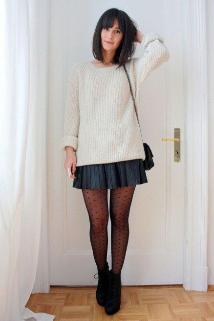 a simple look with a neutral sweater, a black pleated mini, printed tights and black booties