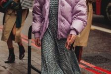 a simple look with a printed grey maxi dress, white trainers and an oversized pink padded coat