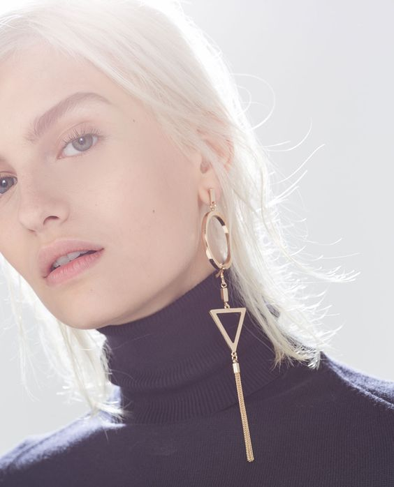 a statement mono earring with a circle, a triangle and a tassel will highlight your look