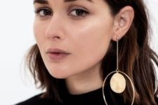 a statement mono earring with a large stone and a large circle is a bold idea
