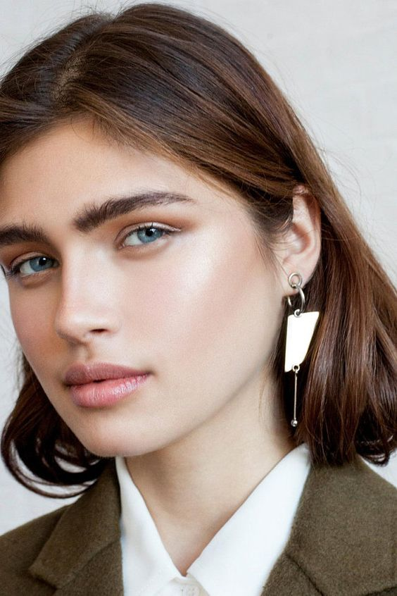 a statement single earring with some hoops and a chain with a bead is a modern idea