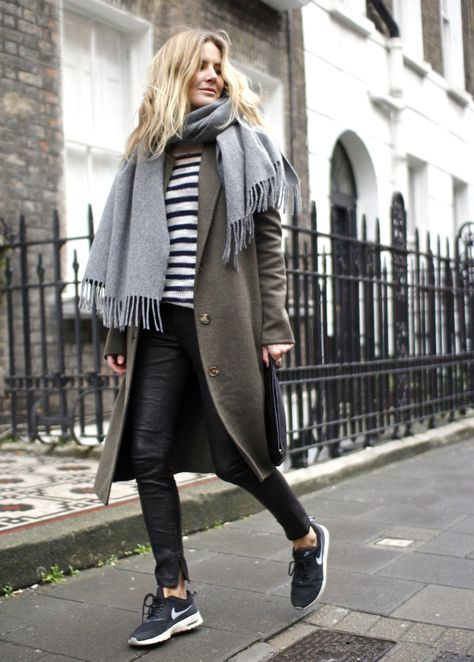 a striped top, black leather pants, black trainers, an olive green coat and a grey scarf for every day