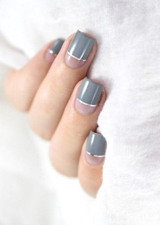 a stylish modern nude and grey manicure with silver stripes is ideal for a minimalist look