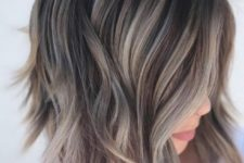 a torn bob haircut with slight waves and a mushroom blond balayage to make your look edgy