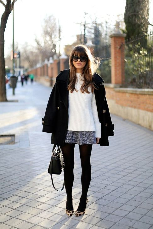 a white sweater, a tweed A-line mini skirt, black tights, animal print shoes, a black coat and a black bag