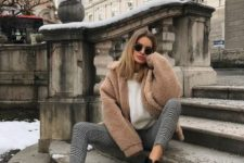 a white sweater, plaid cropped pants, black combat boots and a brown teddy coat for a comfy feel