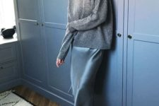 an oversized grey sweater, a blue slip dress and red boots for a bold and colorful winter look