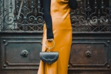 black sock boots, a blakc turtleneck, a marigold slip midi dress and a black bag on a ring for a refined feminine look