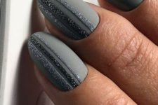 graphite grey nails with two matte ones decorated with glitter stripes look very chic and very bold