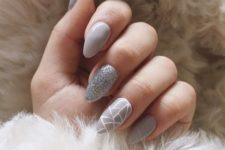 grey nails with two accents – a silver glitter one and a geometric one for an ultimate look