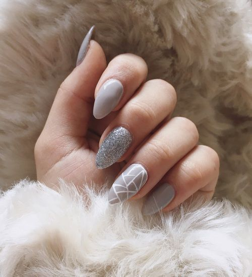 grey nails with two accents - a silver glitter one and a geometric one for an ultimate look