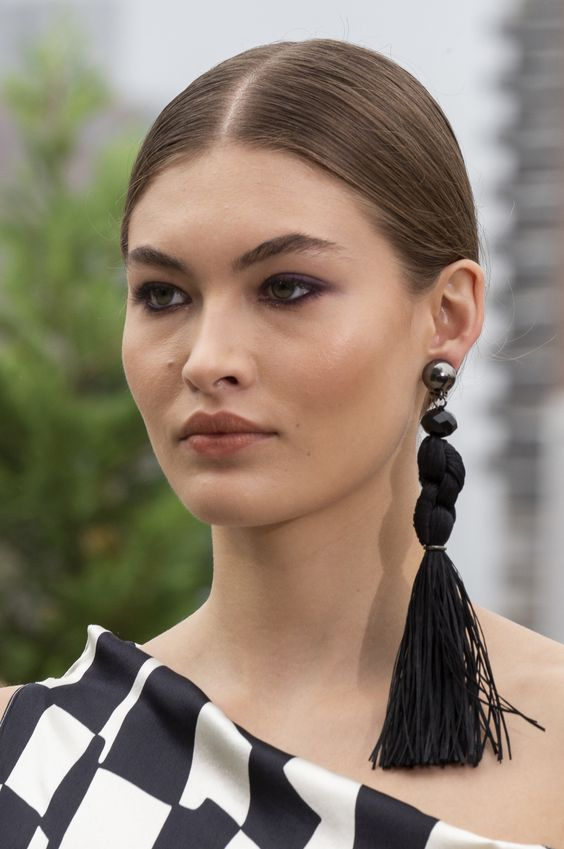 make your monochromatic outfit bolder with such a statement mono earring with a large tassel
