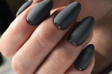 matte graphite grey nails with touches of black glitter look amazing and very bold
