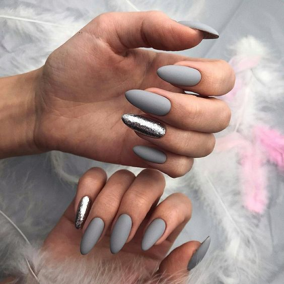 matte grey nails with accent silver glitter nails are amazing for winter holidays, they feel like winter