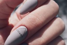 matte grey nails with an accent for a modern and trendy look in a neutral shade