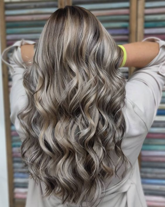 mushroom blond on long hair, with slight highlights and waves is amazing for a super trendy look