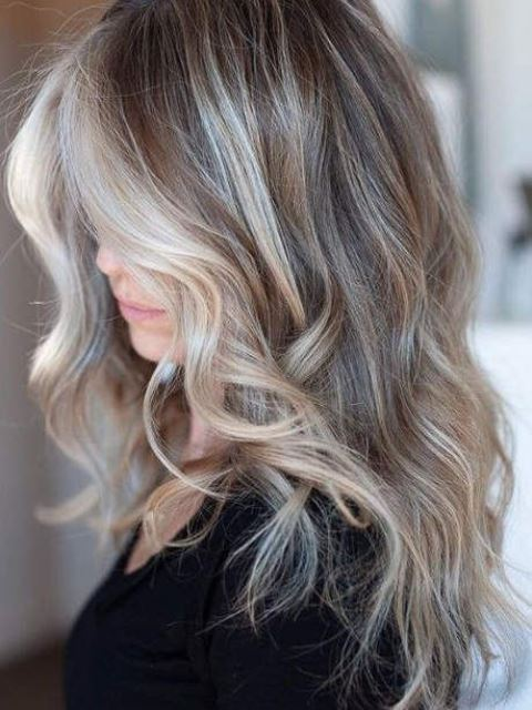mushroom blond with balayage and with slight waves is a trendy idea, especially for edgy medium hair length