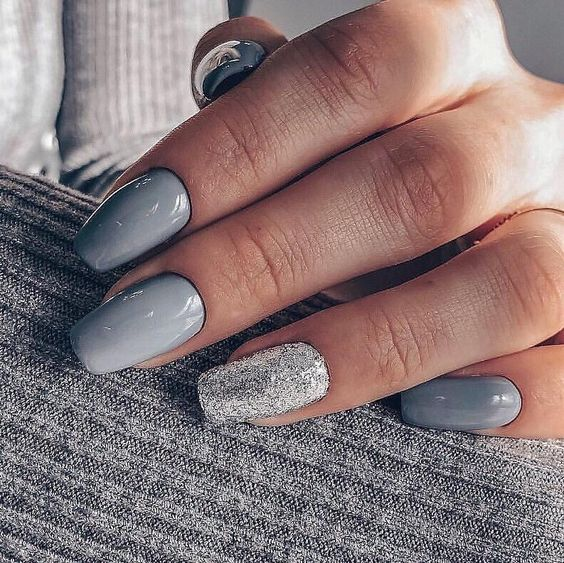 shiny grey nails with an accent silver glitter one are a stylish and cool idea for winter