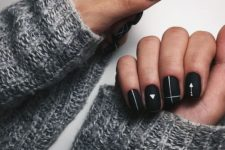 stylish matte black nails with boho white designs are great for a modern girl who loves all things boho
