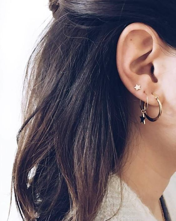 two hoop earrings with a single star hanging and a star stud to match the look