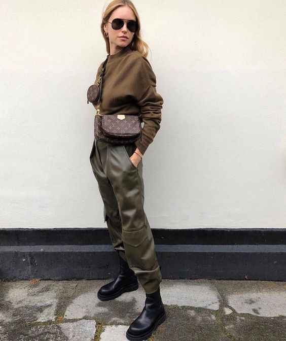 a military inspired look with a brown top, olive green military pants, chunky boots and a simple crossbody