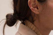 02 a minimalist silver ear hoop cuff with no earrings on is a trendy and edgy accent for a chic look