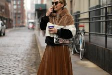 02 a rust-colored leather pleated midi skirt, a color block short faux fur coat and white sneakers for a trendy winter look