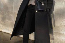 03 a neutral turtleneck, black jeans, a black midi coat, a black bucket bag and black chunky boots