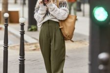 04 a printed oversized sweater, olive green oversized pants, chunky boots and an amber leather bag