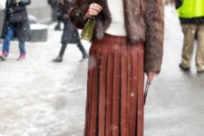 04 a winte rlook with a white top, a brown leather pleated midi, grey booties and a brown faux fur coat