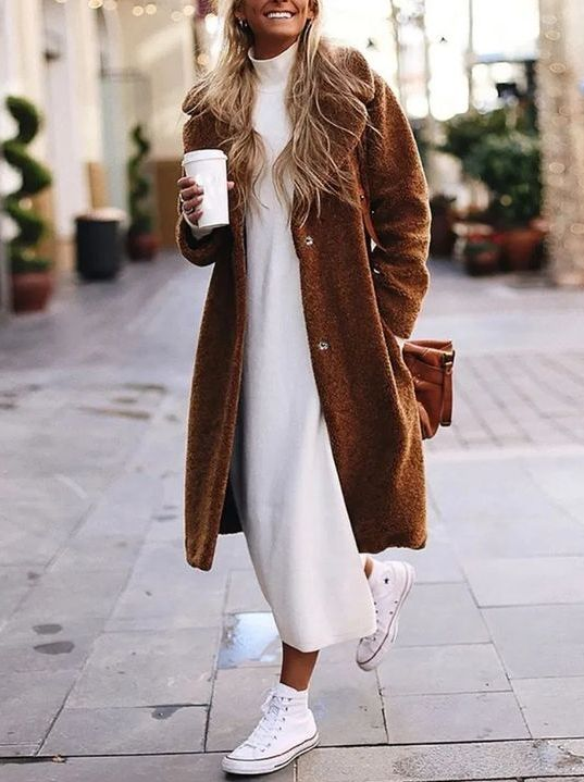 a white turtleneck sweater dress, white sneakers, a brown midi teddy coat and a mathcing bag for a casual outfit