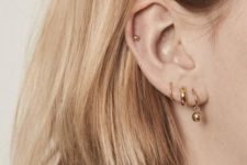 06 gold hoop earrings -a dainty one,a  chunky one and a bead one plus a small gold bead piecring