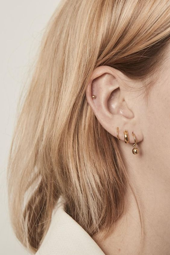 gold hoop earrings -a dainty one,a  chunky one and a bead one plus a small gold bead piecring