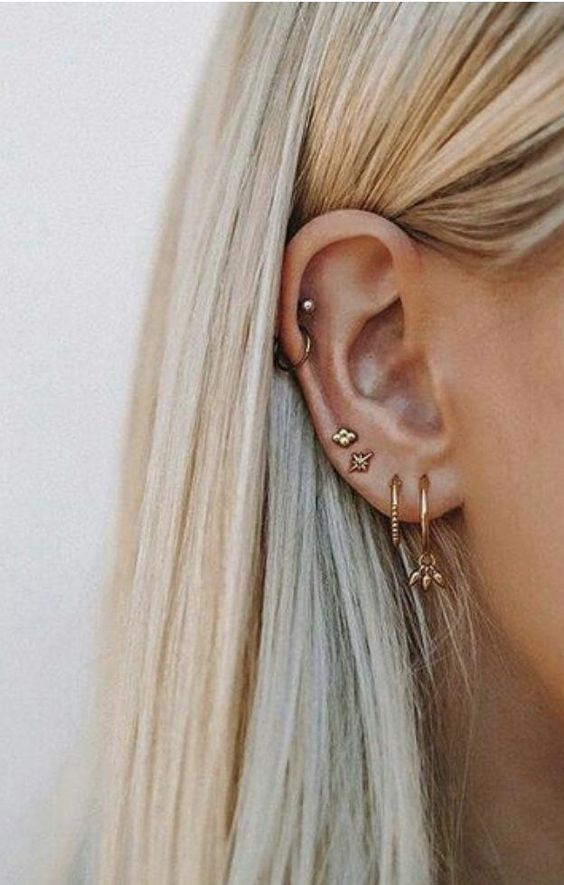 gold studs of various shapes and mini gold hoop earrings with pendants and not for a boho chic feel