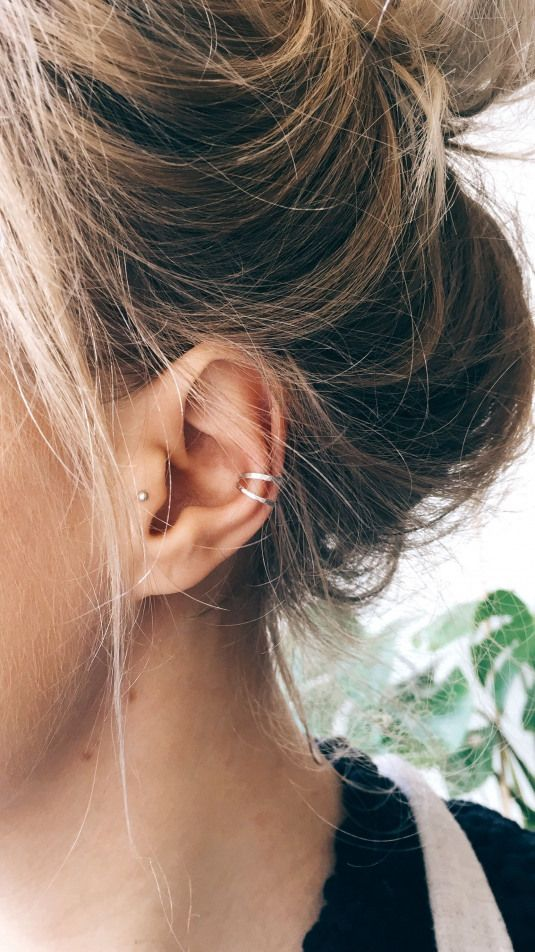 two silver minimalist ear cuffs look very trendy and give a spice to the look immediately