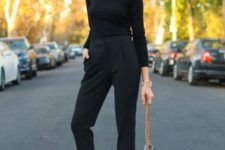 08 a black turtleneck and cropped pants, black heels and a bag on gold chains plus a red lip for a bold touch