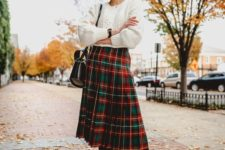 a cozy christmas outfit with a skirt
